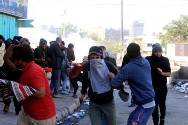 مقتل شرطي عراقي في اشتباكات مع محتجين من أنصار الصدر في بغداد