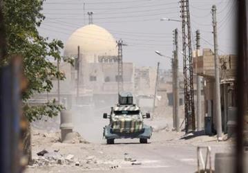 قوات سورية تدعمها أمريكا تسيطر على حي بالرقة من داعش